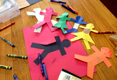 Make your own paper dolls from construction paper. Fun toddler activity!