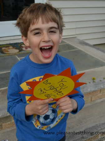 Spread happiness with a construction paper sunburst. An act of kindness AND cutting and writing practice!