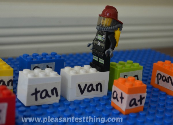 Reading game with LEGO minifigures: rhyming word hop