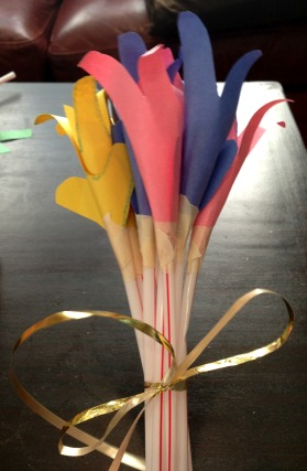Give a gift of paper flowers, made from your child's handprint!
