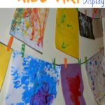 Display your kid's art. This looks easy and cute!