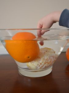Watch density in action with this orange science experiment for kids!