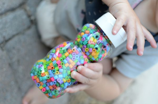 Easy DIY rattle and sensory bottle to make for babies and toddlers.