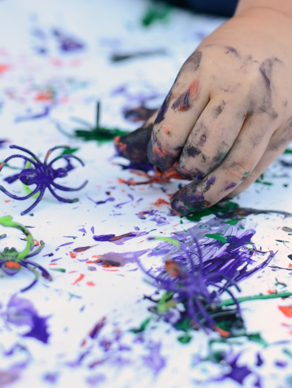 Get messy and creative with this Halloween project - paint with spider rings!