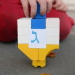 Make your own dreidel using LEGO duplo blocks! Fun Hanukkah activity for kids!