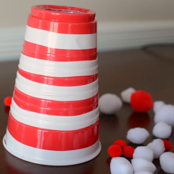 Cat in the Hat game for kids! A fine motor pompom game using the Cat in the Hat's hat!