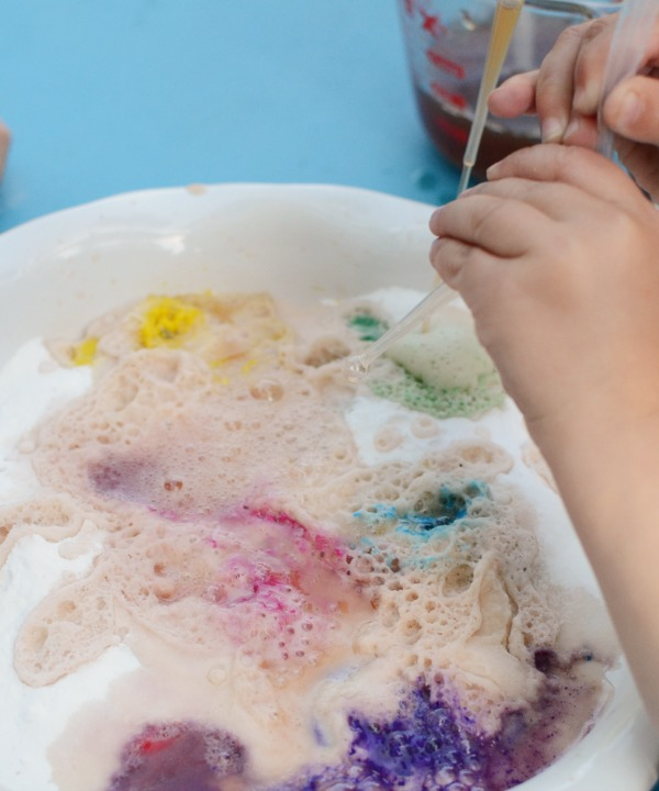 Playful rainbow science project - make a rainbow fizz! Kids will love the mini eruptions of color!