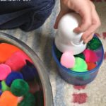 Quick play idea for toddlers - try a pompom sensory bin!
