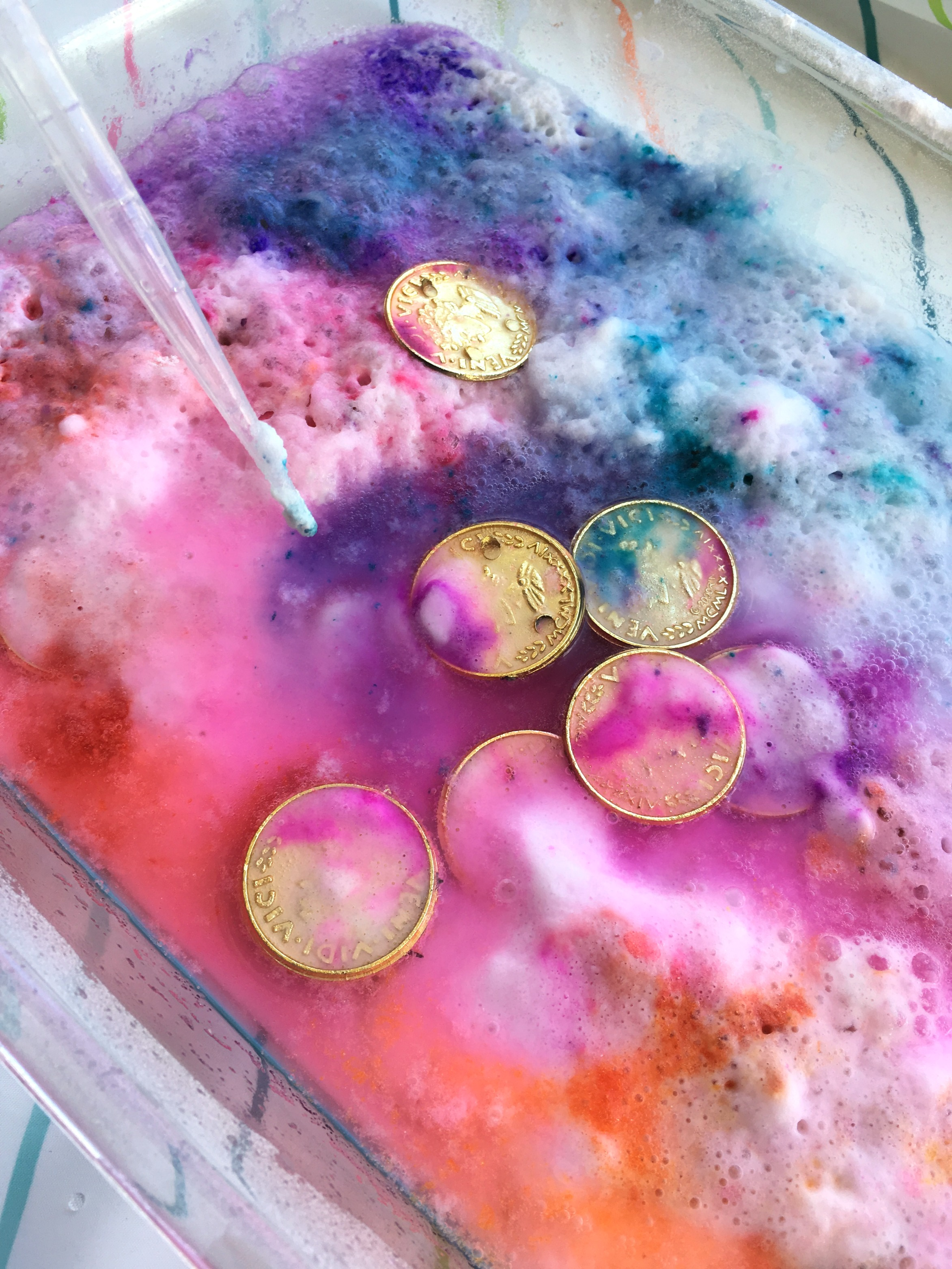 Fizzing science activity for St Patrick's Day: try a rainbow coin hunt!